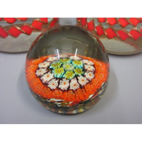 412 - Pair of Murano glass paperweights together with another smaller glass paperweight...