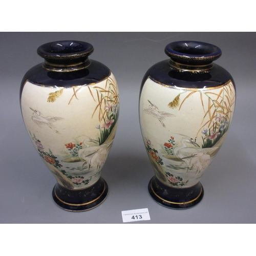 413 - Pair of Japanese Satsuma pottery baluster form vases painted with water birds, 9ins high