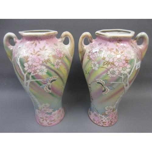 416 - Pair of early 20th Century Japanese hexagonal baluster form vases decorated with butterflies and fol...