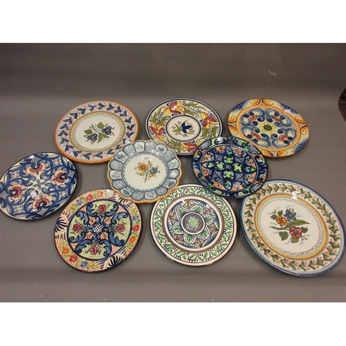 417 - Quantity of various Continental floral painted pottery wall plates