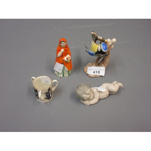 418 - Goebel figure of a blue tit, a Staffordshire candle snuffer in the form of Red Riding Hood, a Lladro...