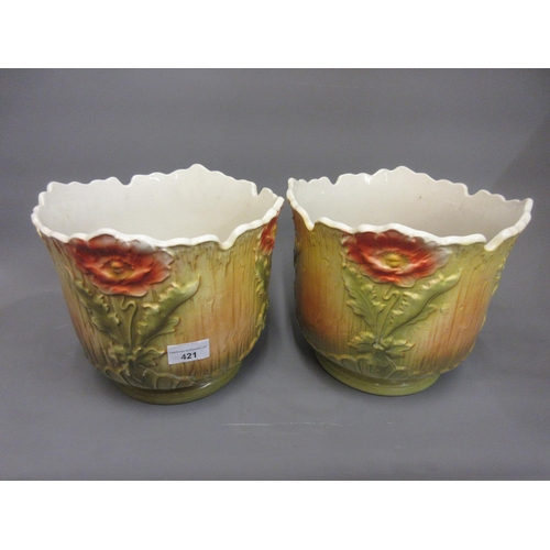 421 - Pair of late 19th or early 20th Century Continental pottery jardinieres with floral decoration in re...