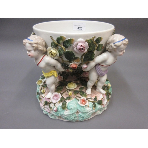 425 - Sitzendorf table centre in the form of a floral encrusted bowl supported by four figures of cherubs ...