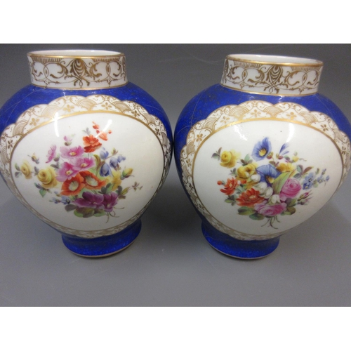 426 - Pair of late 19th Century Continental porcelain baluster form vases painted with vignettes of figure...