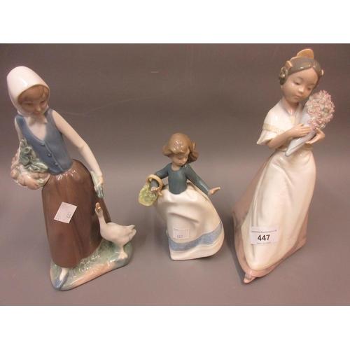 447 - Three various Nao porcelain figures of girls...