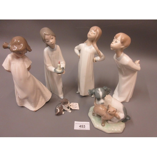 453 - Group of four Lladro figures, one of a cat and two Nao figures...