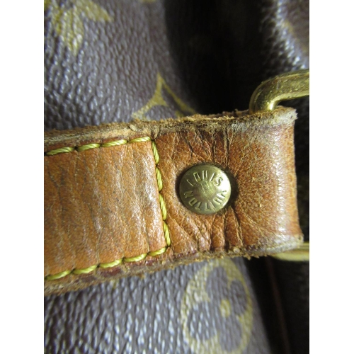 46 - Louis Vuitton vintage holdall with brown leather straps, 17ins x 23ins (with wear)...