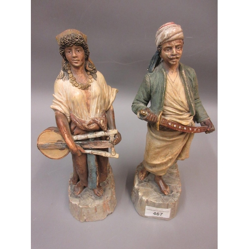 467 - Pair of German painted terracotta North African figures, man with a sabre and lady with a musical in...