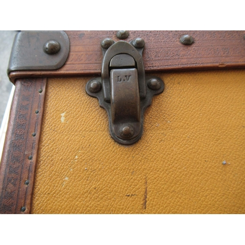 47 - Early Louis Vuitton yellow canvas covered suitcase with lozine trim and brass fittings, the buttons ...