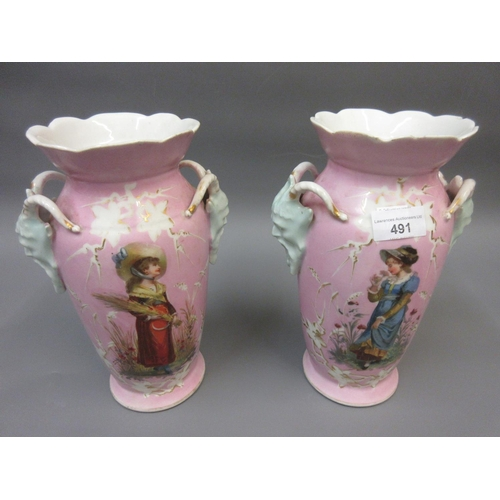 491 - Pair of 19th Century French baluster form vases with mask head handles decorated with figures and fl...