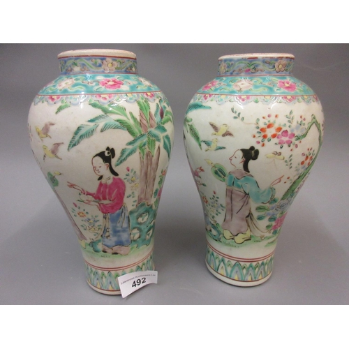 492 - Pair of Chinese Canton enamel vases decorated with figures, 8.5ins high