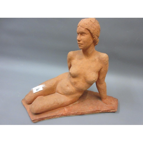 507 - Mid 20th Century terracotta figure of a reclining female nude, 30.5ins x 16ins approximately