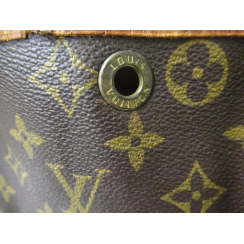 52 - Louis Vuitton, ladies bucket bag with leather strap and leather tie top...