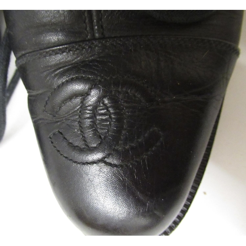 53 - Pair of ladies Chanel black leather lace-up tall combat boots, size 7...