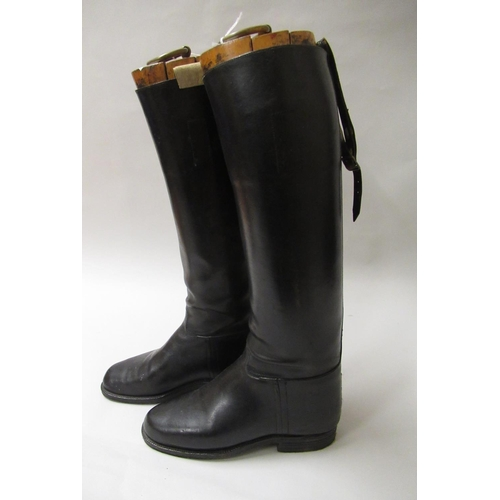 55 - Pair of black leather riding boots with trees having gilt ring pull handle and label for Alan McAfee...