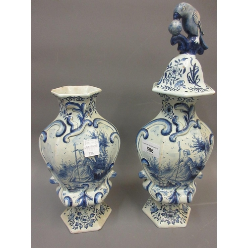 586 - Pair of Delft hexagonal baluster form vases decorated in blue and white (one cover lacking)