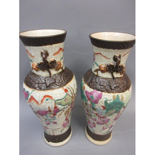 596 - Pair of early 20th Century Chinese crackleware vases painted with figures, 10ins high