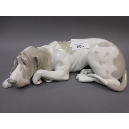 606 - Lladro figure of a reclining bloodhound, 10ins wide