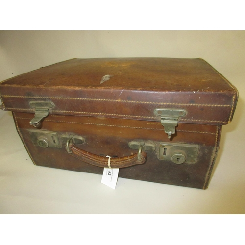63 - Tan leather dressing case with nickel plated catches...