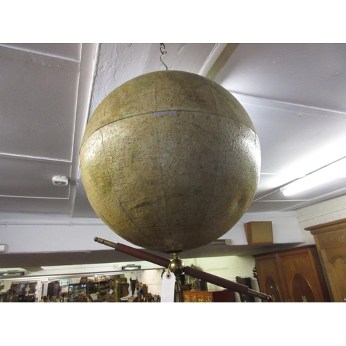 64 - Philips' 19in terrestrial globe, the aluminium body with paper covering and brass suspension system...