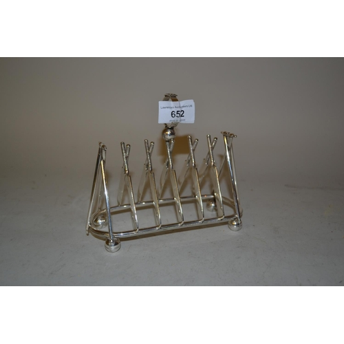 652 - Unusual silver plated toast rack modelled in the form of cricket bats, stumps and balls...