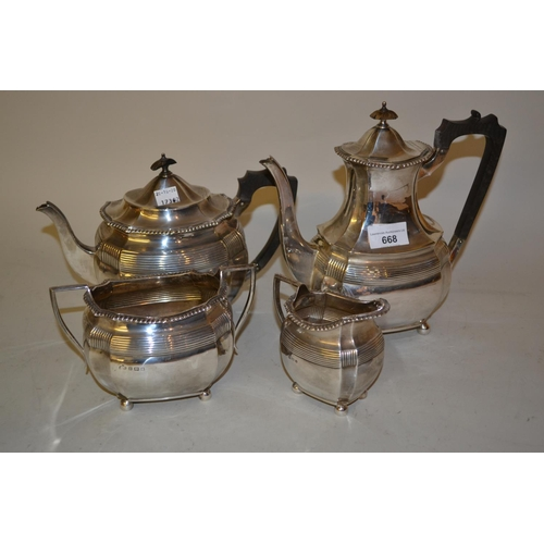 668 - Birmingham silver four piece teaset with ebony handles and finials (one at fault), 59ozs...