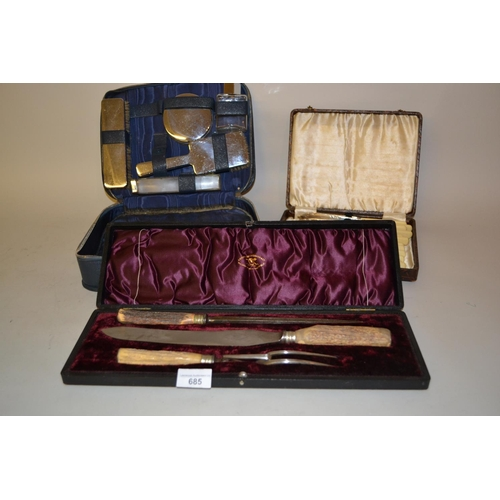 685 - Steel horn handled three piece carving set in fitted box, plated set of fish knives and forks and a ...