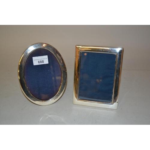 688 - Modern rectangular silver photograph frame and an oval silver photograph frame...