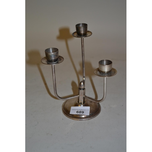 689 - Danish silver plated three branch candelabra of modern stylised form, marked ' Berg.Denmark '...