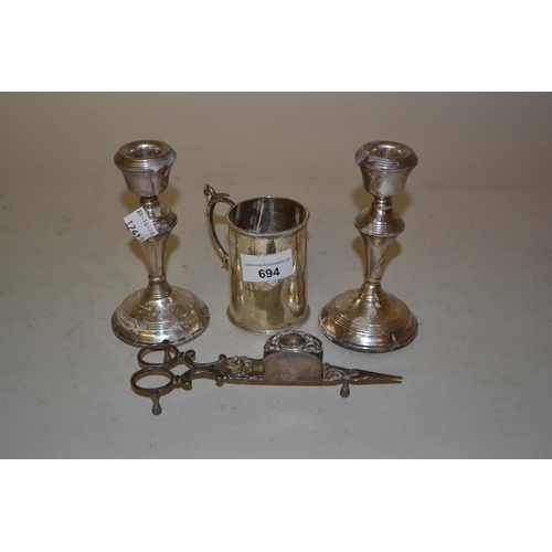 694 - Pair of Birmingham silver baluster form candlesticks, London silver Christening mug engraved 'Nellie...