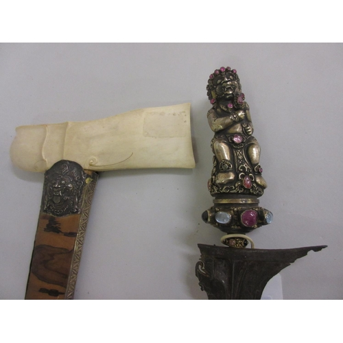 72 - Good quality Malasian kris, the silver gem inset grip in the form of a mystical figure on a wavy ste...