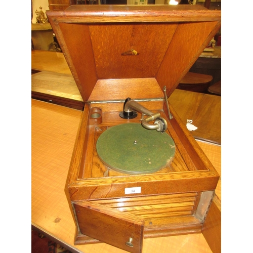 78 - Oak cased table top wind-up gramophone by HMV...