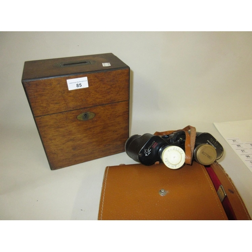 85 - Victorian oak two bottle decanter box and a pair of Swallow binoculars...