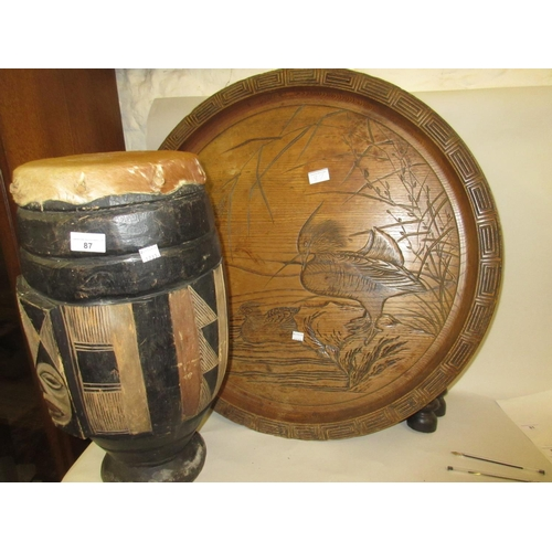 87 - African native drum together with a Japanese carved circular tray top occasional on a folding stand...