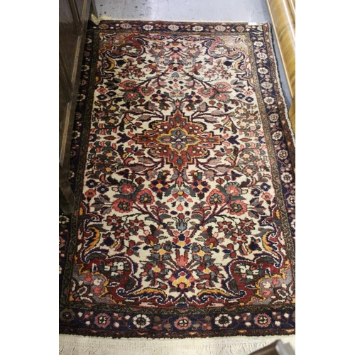 9 - Small Saruq rug with a medallion and floral design on ivory ground with borders, 5ft x 3ft approxima...