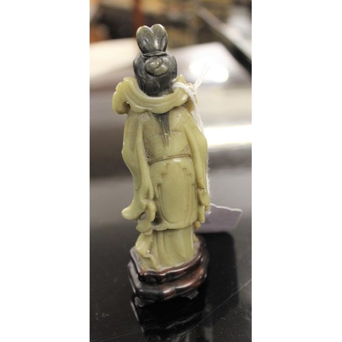 138 - 20th Century Chinese carved jade pendant on a stand, together with two other small similar carvings...
