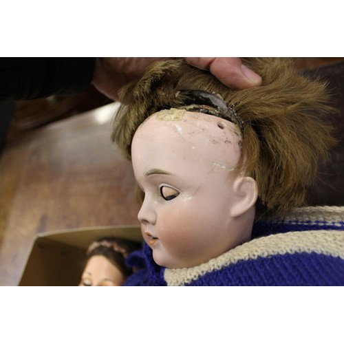 134 - German bisque headed doll (at fault) together with a composition doll and a Japanese costume doll...