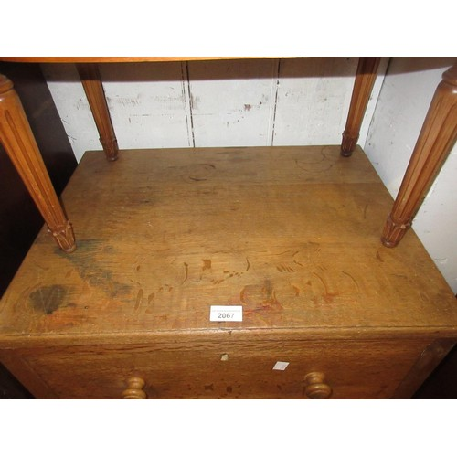 2067 - Mid 20th Century Heals three drawer oak chest with knob handles...