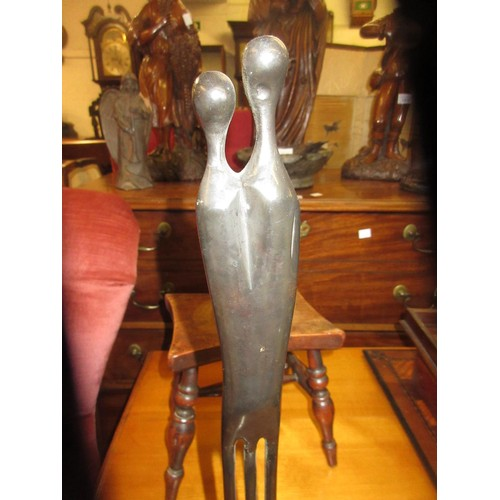 2075 - 20th Century bronze group of two stylised figures...