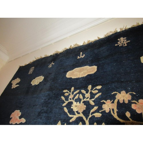 3 - Chinese rug woven with a landscape design in shades of blue, pink and beige beneath a row of seven C...
