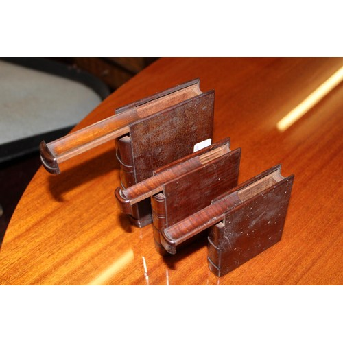 116 - Graduated set of three small mahogany puzzle boxes in the form of books...