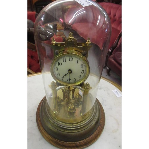 1549A - Early 20th Century brass anniversary clock (at fault) under glass dome...