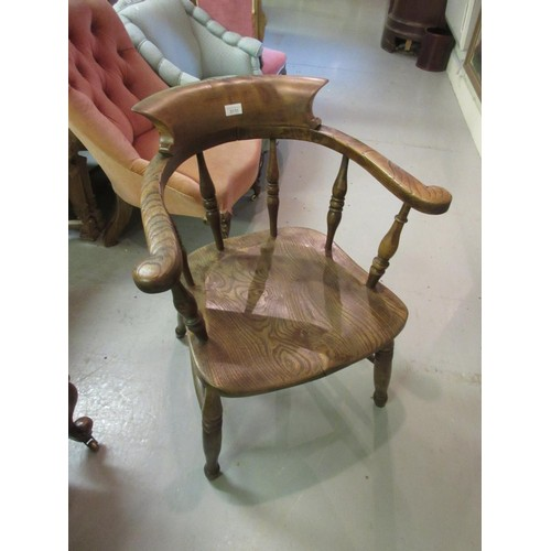 2135 - 19th Century oak and elm Captain's chair on turned supports with H-stretcher...