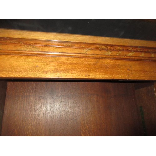 2105 - Pair of early 20th Century oak double sided open bookcases, the moulded cornices above adjustable sh...