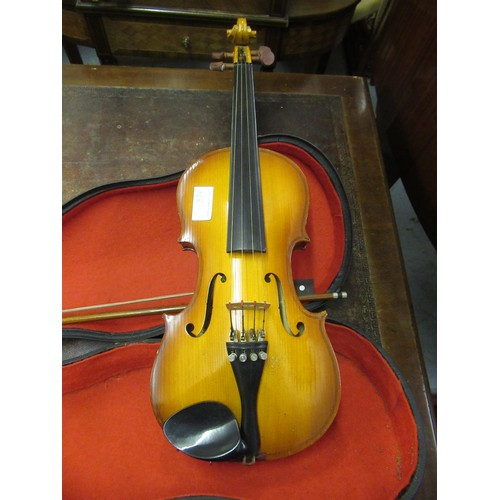 128 - West German violin with two piece back (Stradivarius copy), with case and bow, together with two oth...