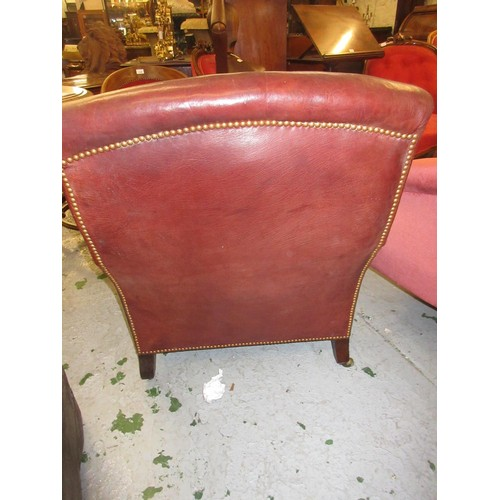 2062 - Howard & Sons library / Grafton armchair having square tapering mahogany front supports, stamped How...