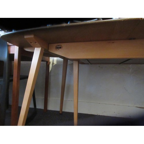 2095 - Ercol mid 20th Century pale ash pull-out extending dining table...