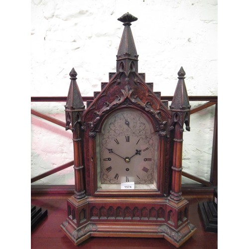 1574 - 19th Century figured walnut bracket clock of Gothic Revival design, the architectural case with thre...