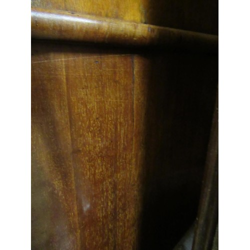 1627 - Victorian mahogany linen press, the moulded cornice above a pair of panelled doors enclosing sliding...