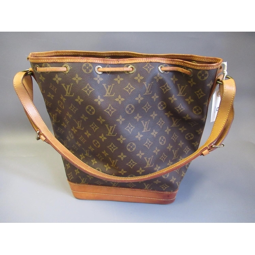 12 - Louis Vuitton, ladies bucket bag with leather strap and leather tie top...